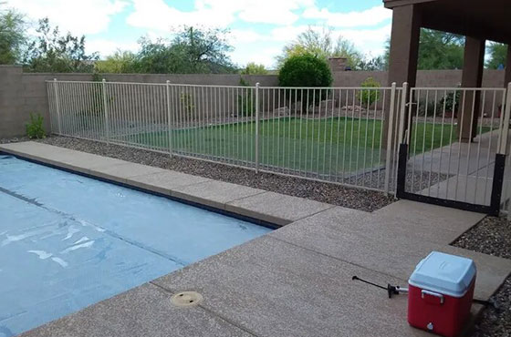 backyard pool with a fence